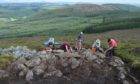 "University of Aberdeen of archaeologists at work on Tap O' Noth hill near Rhynie in Aberdeenshire where they have unearthed a ""mind-blowing"" Pictish site believed to be the largest ever discovered."