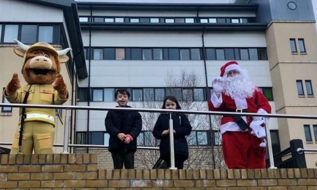 Harry and Ella with Santa and a Firefighter Bull.