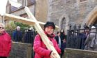 Rev Julia Meason, carrying a cross on the annual Walk of Witness.