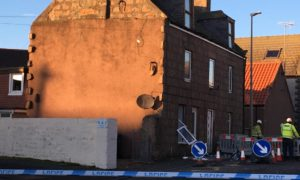 Debris from the home explosion-hit home at 37 North Street, in Peterhead. Kathryn Wylie/DCT Media Date; 03/12/2020