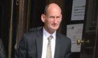 Robert McAlley leaving court.