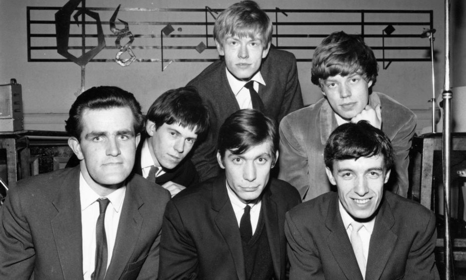 The Rolling Stones with Ian Stewart on the far left.