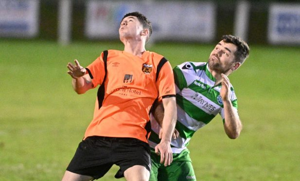 Jack Brown, left, in action for Rothes.