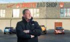 Dez Cheyne BEM outside the Spotty Bag Shop in Banff
