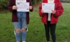 Jade Allan and Kirsty Arnaud, activists in the group Stand Up i Pefferside Park, Dingwall, supporting the global campaign against gender-based violence