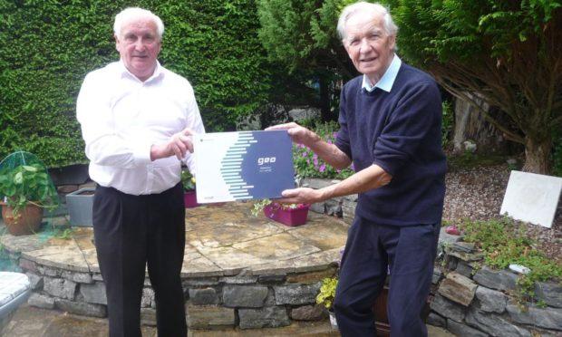 John MacKenzie, chairman of Badeoch Shinty Memories (left) and Donnie Grant, Shinty Memories ambassador