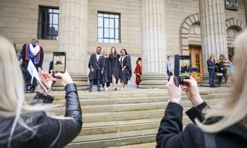 Students graduating before the coronavirus pandemic.