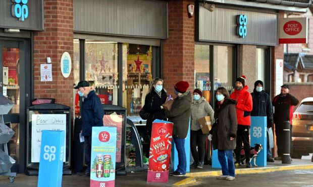 People queueing at the Post Office in Stonehaven, which is incorporated into the Kirkton Road,  Co-op Petrol Station.