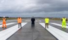 Runway resurfacing works have been completed at RAF Lossiemouth. Pictured: Keith Mablethorpe, VolkerFitzpatrick Project Director, Russ Liddington, DIO Project Manager, Wing Commander James Ash, RAF Lossiemouth, Wing Commander Pete Beckett, Lossiemouth Development Project, Andy Reynolds, VolkerFitzpatrick Operations Manager.