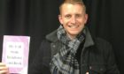 Martin Gillespie from Skerryvore with the cookbook.