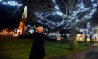 Pictured is Anne Reid, the secretary of Ballater Enhancement Group, in the village square with the Christmas lights.
