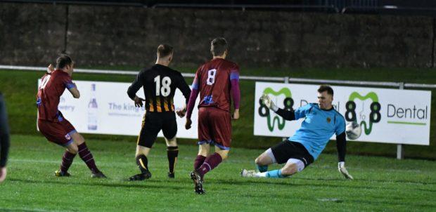 Michael Selfridge, left, nets Keith's opener against Huntly