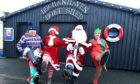 Father Christmas with helpers, Alex Donaldson, Jill Donaldson and Sarah Donaldson at Buchanhaven Boat Shed.