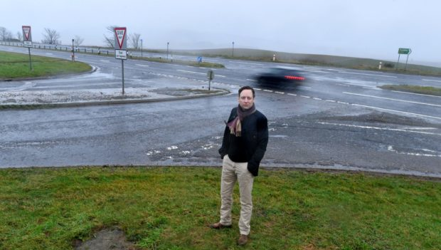 Liam Kerr MSP at the junction between the road to Drumlithie and the A90 Stonehaven to Dundee road.