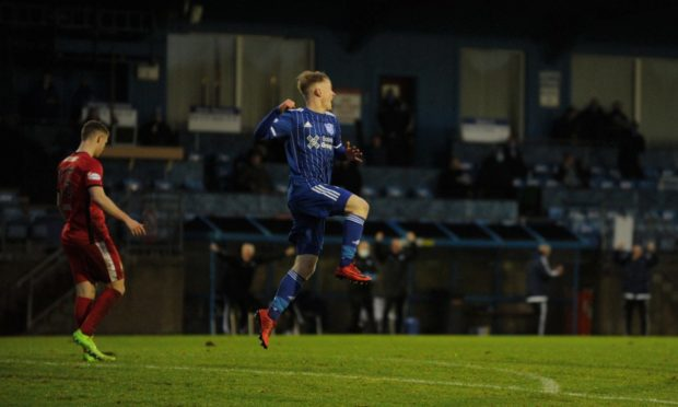 Peterhead's Lyall Cameron celebrating after scoring against East Fife.
