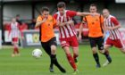 Rothes' Ally Stark (left) tangles with Formartine United's Daniel Park