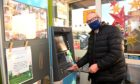 Councillor Ron McKail at the new cash machine at the Coop, Westhill Shopping Centre.