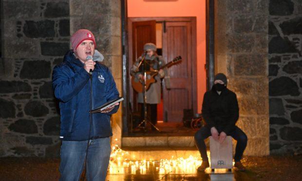 The doorstep caroling was organised to bring cheer to Fetterangus.