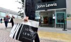 Shoppers outside the Aberdeen branch of John Lewis, which has made funding available to charity Home-Start.