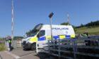 Police teams at Carmont signal box.