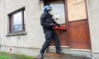 Police raid a residential house in Thurso, Sutherland.