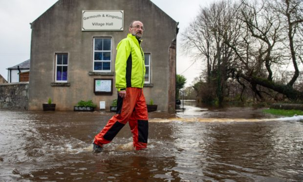 Garmouth resident Nigel Sanderson during the most recent flood.