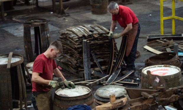 Coopers hard at work in Speyside Cooperage.
