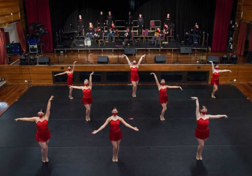 Performers from Lossie Entertainment Academy rehearse for That's the Spirit at Elgin Town Hall.