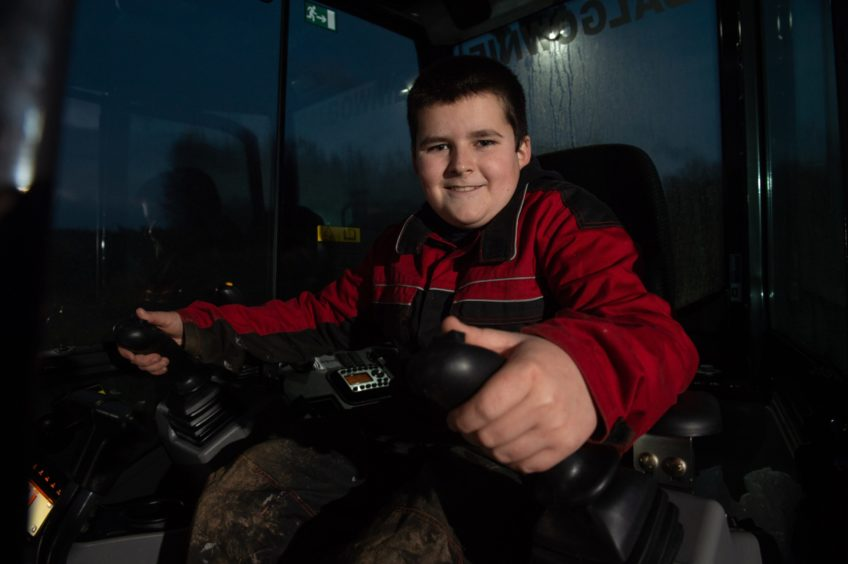 Jamie Currie, 13, at the controls.