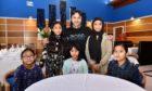 Raj  Hamid, centre, with his daughters L-R) Bushra, Hazera, Maryam, Kolsuma, Jamila.