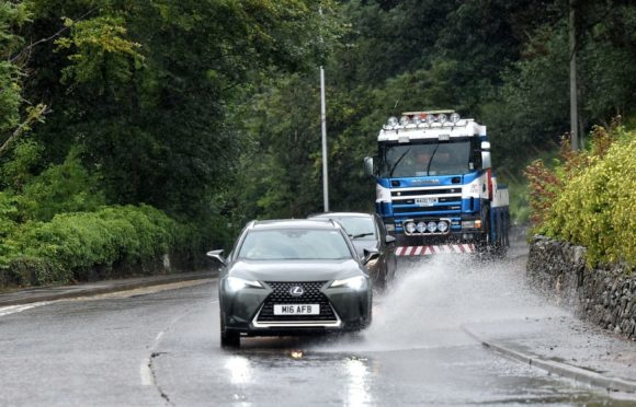 Heavy rain could cause flooding on roads across Aberdeen, Aberdeenshire and Moray.