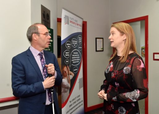 North East Sensory Services chief executive Graham Findlay meets social security secretary Shirley-Anne Somerville at the charity's Aberdeen base in St John Street earlier this year. Picture by Scott Baxter