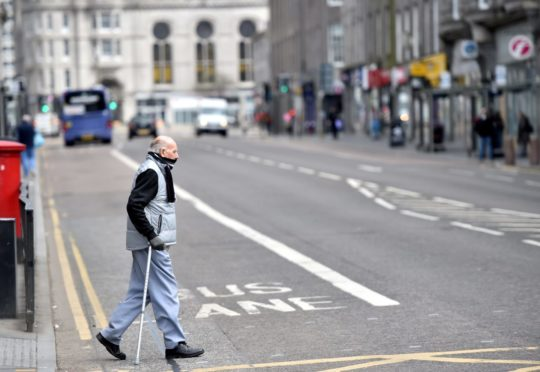 General views in Aberdeen during Covid-19 pandemic.  Pictured is a man on Union Street wearing a scarf as a mask.   Picture by Scott Baxter    28/04/2020