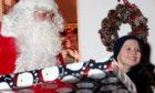 Five-year-old Leo Middleton gets surprised by Santa.