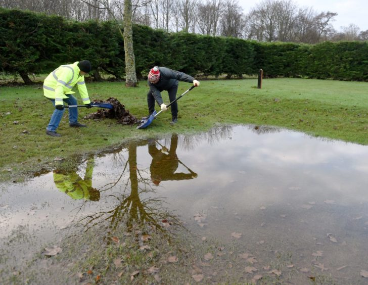 Clear up operations at Garmouth and Kingston Golf Club after the most recent flood.