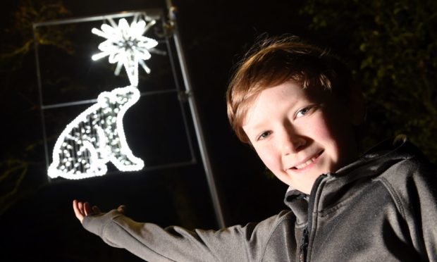 Hamish Ball with his design for a Christmas light.