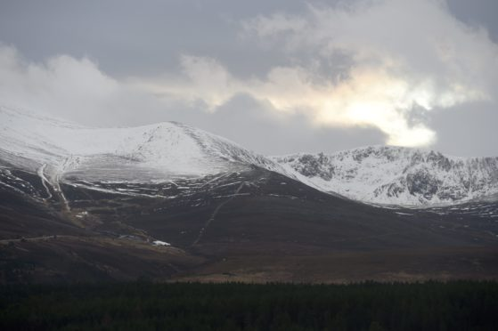 Picture by SANDY McCOOK    21st December '20 A low winter sun tries to shine on Cairngorm and the northern corries which have some early snowfall.