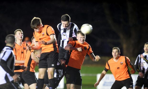 Rothes, pictured in orange, are looking to arrange a pre-season friendly