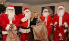 Helen Will with her volunteer santas