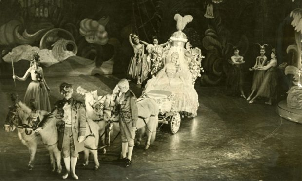 Showtime!: A coach and horses carry Cinderella to the pantomime ball at His Majesty's Theatre, Aberdeen in 1955.
