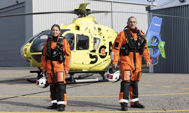 Lead paramedic Ewan Littlejohn and team-mate Laura McAllister at Aberdeen International Airport.