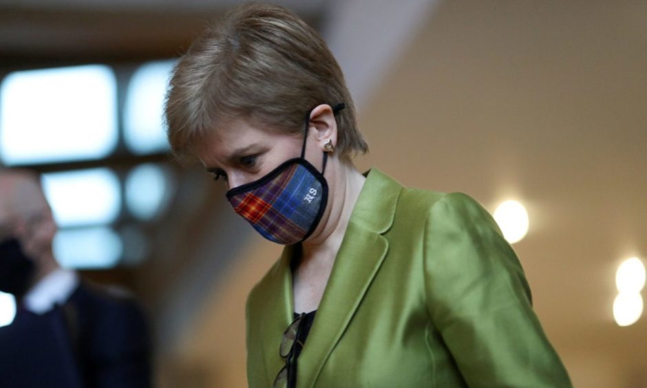 Nicola Sturgeon arrives for First Minister's Questions at the Scottish Parliament in Edinburgh.