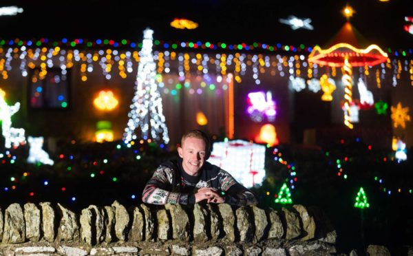 Callum Stuart unveils annual fantastic festive light display to bring Christmas cheer and raise funds for Keith and District MS group.
