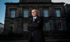 Former British Army soldier, Alan Duncan, pictured standing outside Elgin Sheriff Court.