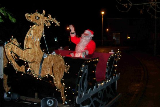 Alford and District Rotary Club's annual Santa sleigh fundraiser will have special Covid-19 measures in place for Christmas 2020. Pictured: the club's annual Santa sleigh fundraiser in 2019 .