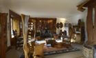 The Tim Stead Trust wishes to purchase the artist's home in the Borders, called The Steading, for the benefit of the nation. The living room, complete with many of Mr Stead's carvings.