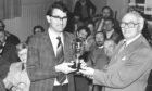 David Dolman is presented a gardening trophy by Gordon District Council chairman James Presley on November 1, 1978.