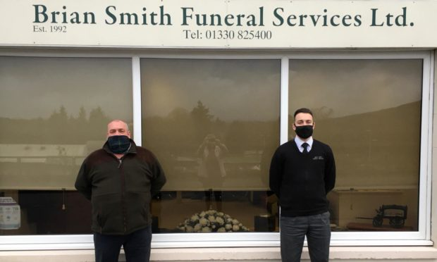 Brian Smith, left, and his son Sam Smith outside the Brian Smith Funeral Services office in Banchory.