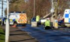 Police on  scene at Springhill Road, Aberdeen.   Picture by Jim Irvine  2-12-20