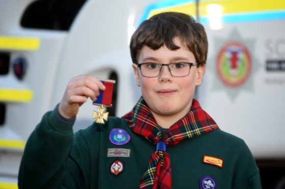 Cameron Barnes received special recognition from the Cub Scouts for saving his family home from a fire earlier this year.